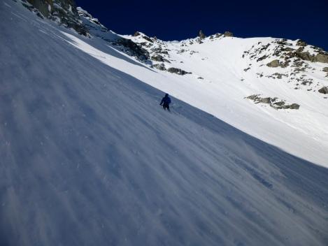 Tomas skiing the face