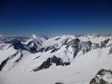 Finsteraarhorn summit view over towards the Aletschhorn, Grosse Grunhorn and the Jungfrau