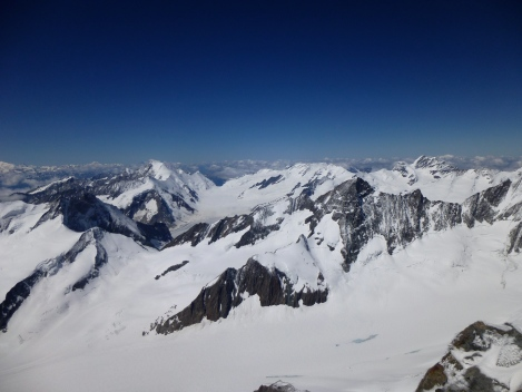 Finsteraarhorn summit view over towards the Aletschhorn, Grosse Grunhorn and the Jungfrau