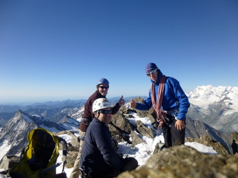 The team putting on crampons on the subsiduary summit.