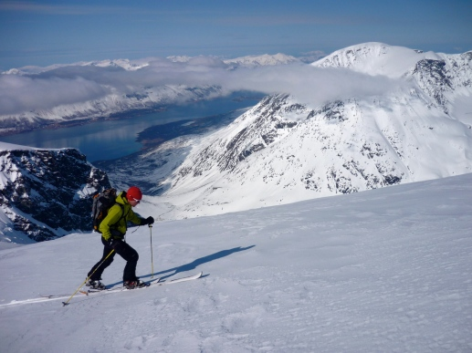 Skinning up towards Jiehkkevárri, the highest summit on the southern island.