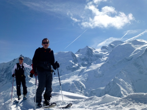 the guys on the summit with Mt Blanc in the background