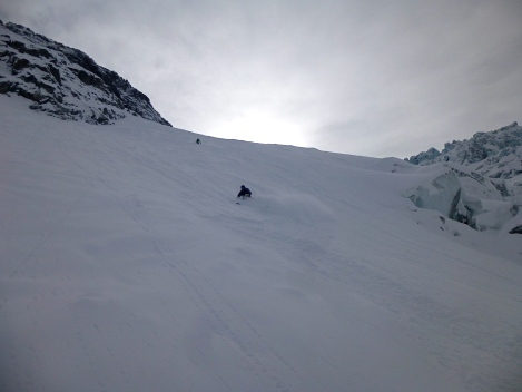 The sun dimmed by incoming weather on the Italian Vallee Blanche