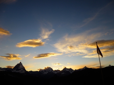 sunset with the Matterhorn and the flag of the Monte Rosa hut silhouetted