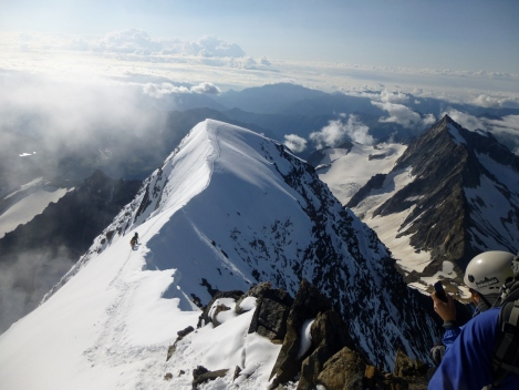 a party on the summit ridge of the Weissmies